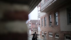 Couple hugging on the old street view from the corner - stock footage