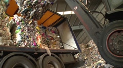 Waste for recycling purposes being loaded in recycling center Stock Footage
