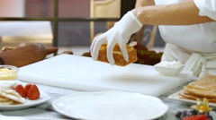 Hands put cake on plate. Stock Footage