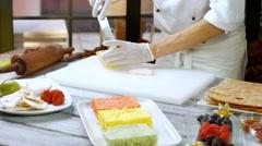 Spatula puts custard on shortcake. Stock Footage
