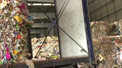 waste for recycling purposes being loaded in recycling center - stock footage