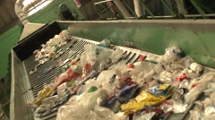Trash to recycle in a conveyor belt in recycling center Arkistovideo