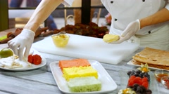 Spatula putting custard on shortcake. Stock Footage