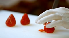 Hand with knife cuts strawberry. Stock Footage