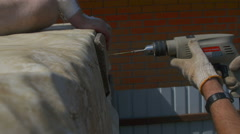 A man tightening the bolt with a drill Stock Footage
