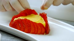 Hands touch strawberry slices. Stock Footage
