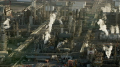 Aerial view industrial gas tanks at Los Angeles city fuel refinery Stock Footage