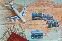 Money, passport, plane and pictures on the map with the background of the Russia Stock Photos