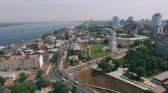 aerial of cityscape, park, modern and historic building, bell tower, car traffic - stock footage