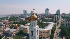 Camera is flying around golden dome of Orthodox monastery bell tower Stock Footage
