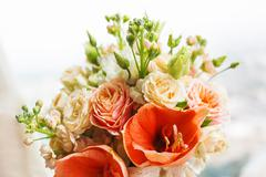 Wedding bouquet on window sill. Bride's traditional symbolic accessory. Flora Stock Photos