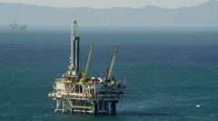 Aerial view of oil drilling platform offshore Los Angeles California Stock Footage