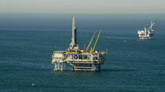 Aerial view of offshore platform drilling for oil Pacific Ocean California Stock Footage