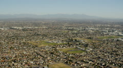 Aerial view of suburban homes and streets in Los Angeles California Stock Footage