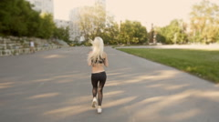 Athletic Blonde Woman Running. Female Runner Jogging. Outdoor Workout - stock footage