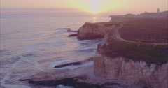 Aerial cliff edge and people at shark fin cove during sunset, santa cruz Stock Footage