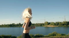 Athletic Woman Running near the Beach. Female Runner Jogging. Outdoor Workout Stock Footage