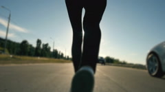 A woman running in the sunset legs silhouette - stock footage