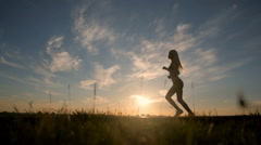Silhouette of a sexy fit woman girl running at sunset. Training, jogging Stock Footage