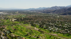 Aerial view of suburban homes and highways Palm Springs USA Stock Footage