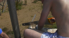 A man sawing the plank Stock Footage