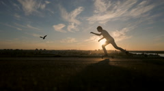 Young skaters training in the park in sunset. Birds Stock Footage