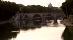 Rome, the Tiber River in the late afternoon with St Peter's in the backgound. - stock footage