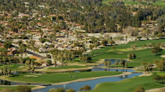 Aerial view of luxury golf courses in Palm Springs California Stock Footage