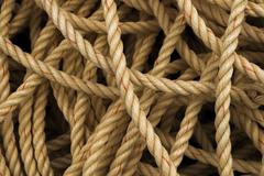 Pile of old fisherman's rope - stock photo