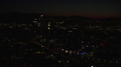 Aerial night view of illuminated buildings in downtown Los Angeles Stock Footage