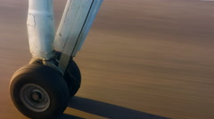 4K Aircraft Landing Gear and Wheel Moving over Airport Tarmac while Taxiing - stock footage