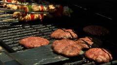 Double grilling burgers and kabobs Stock Footage