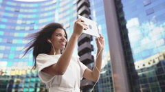 Woman making a video call via computer tablet in a big city Stock Footage