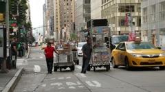 Manhattan New York City Food Cart Men and Traffic Stock Video Stock Footage