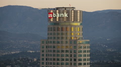 Aerial sunrise view in close up of Bank of America skyscraper Los Angeles USA Stock Footage