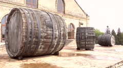 Big wood casks and house Stock Footage