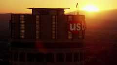 Aerial view of sunrise silhouette US Bank building Los Angeles Stock Footage