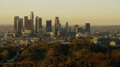 Aerial view at sunrise of Los Angeles financial buildings California USA Stock Footage