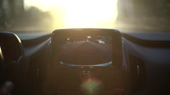 A car's backup camera in action at sunset. Close up Stock Footage