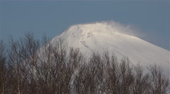 The mountain and the volcano Avacha snowy peaks spewing warm vapors from the Stock Footage