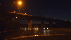 View from back of car. Driving north at night on DVP in Toronto, Canada Stock Footage