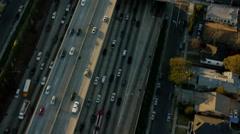 Aerial view American freeway traffic in Los Angeles California Stock Footage