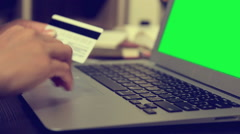 Woman using credit card with laptop green screen shopping online Stock Footage