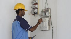 indian electrical engineer doing works - stock footage