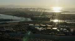 Aerial sunrise view of industrial petrochemical plant Los Angeles Stock Footage