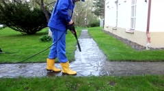 Professional worker spray concrete path with special high pressure tool Stock Footage