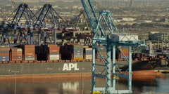 Aerial view of container ship and port gantry's Los Angeles port California Stock Footage