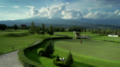 Golf course with beautiful mountain scenery and clouds Stock Footage