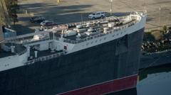 Aerial view of Queen Mary liner docked at Long Island California Stock Footage