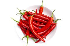 A Bowl of Many Chilli Peppers Stock Photos